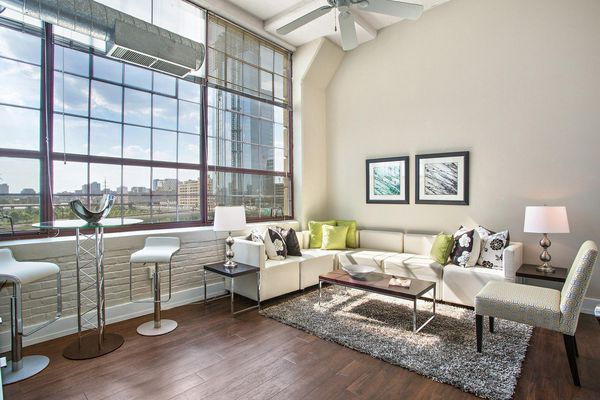 Loft floor plans with 12-foot ceilings and industrial-style windows