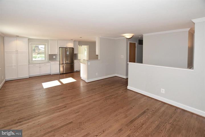 View from living room to kitchen. - Updated Single Family Home walking distance to GMU and Old Town Fairfax Rental