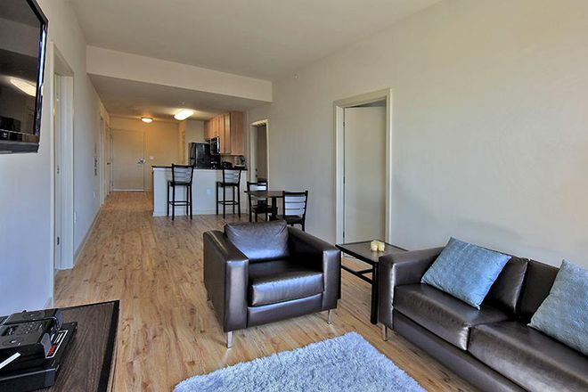 Open Area Living Room & Kitchen - HH Midtown - Luxury Student Apartments Steps Away from UB and JHU!