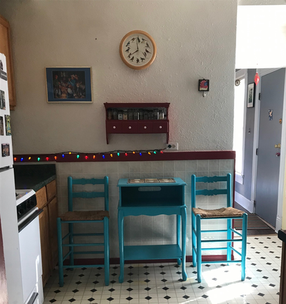 Little seating area in kitchen - Furnished well-lit, bohemian apartment close to Regis.  Entire Apartment . Peaceful Writing Haven.