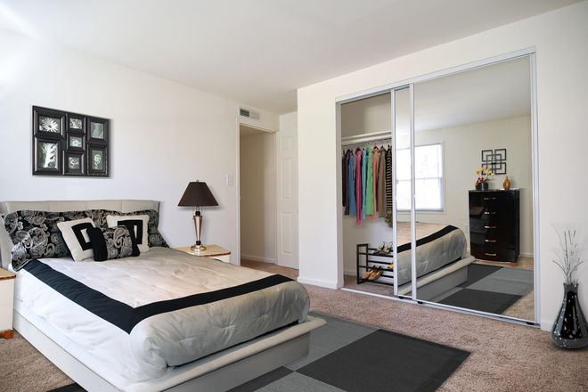 Bedroom with Mirror Closet Doors