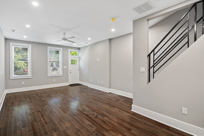 First to second floor stairs - Beautifully Renovated Christian Street Home Close to Campuses Rental