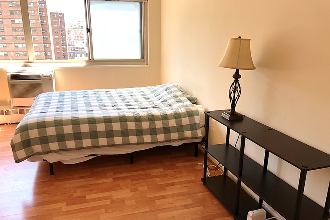 main: bed shelving unit - LOCATION! Large Sunny Riverview Studio near Rittenhouse Sq/University City (ALL UTILITIES INCLUDED) Condo