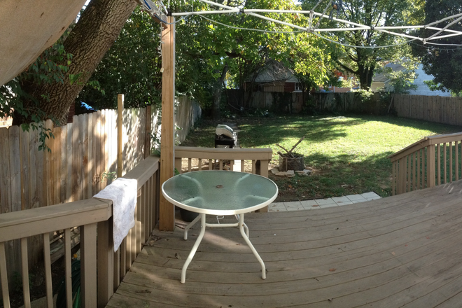 back deck with large shaded backyard - //// Luxury 2-bedroom apt- Fully Remodeled