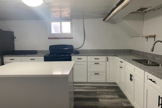stone counters & new cabinets. - Remodeled 1 bedroom apartment available now