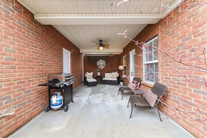 covered patio - no furniture - Comfy-upscale townhome at the right price!