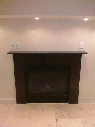 Gas Fireplace with Mantle in Living Room - Luxury 2 bedroom Condo Unit with fireplace
