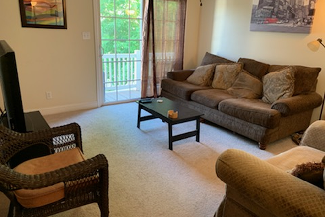 Living Room with outside porch - Beautiful Wyndhurst Condo no payment for utilities
