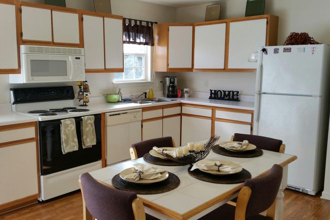 The eat-in, wrap-around kitchen features a separate pantry and ample cabinetry for all of your cookware and dishes. We make moving in easy with all furniture and full-size matching appliances included, utilities on and ready to go. The full-size washer and dryer saves you and your roommates trips to the laundromat, while the breakfast bar, patio or deck and outdoor picnic area let you change up yo
