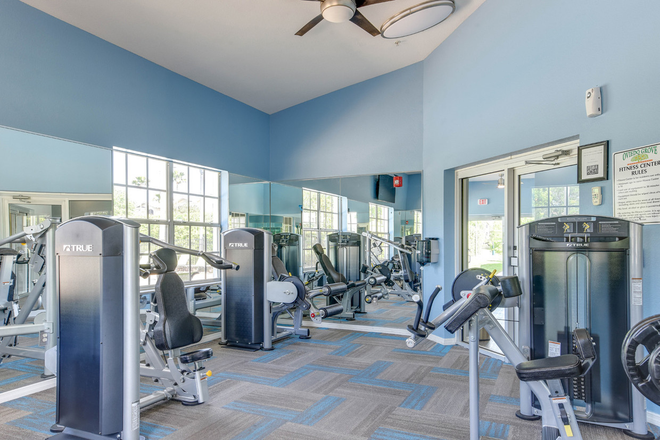 24-hour fitness center with cardio and weights