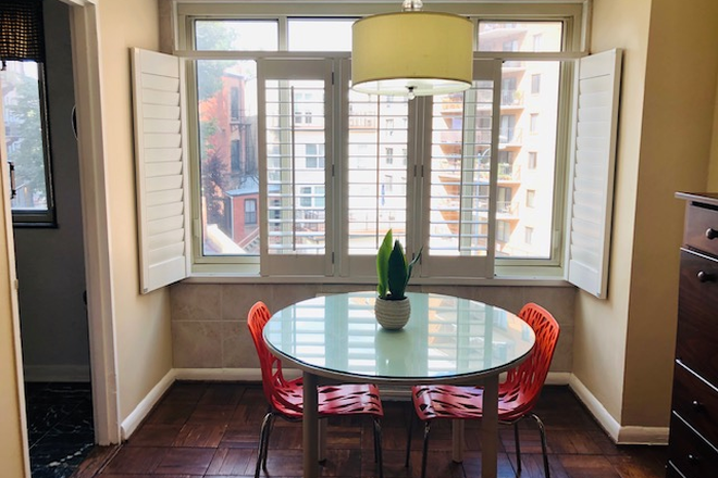 "Dining room with plantation shutters - DuPont Circle - Furnished Jr. 1- Bed.  WIFI & utilities included -50 "" Roku Smart TV -1 block to M Condo"