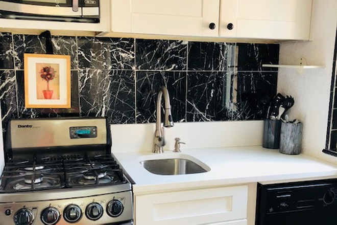 "Kitchen with Quartz counter - DuPont Circle - Furnished Jr. 1- Bed.  WIFI & utilities included -50 "" Roku Smart TV -1 block to M Condo"