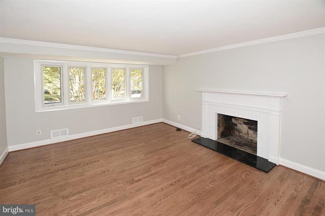 Bright, sunny living room on main level. - Updated Single Family Home walking distance to GMU and Old Town Fairfax Rental