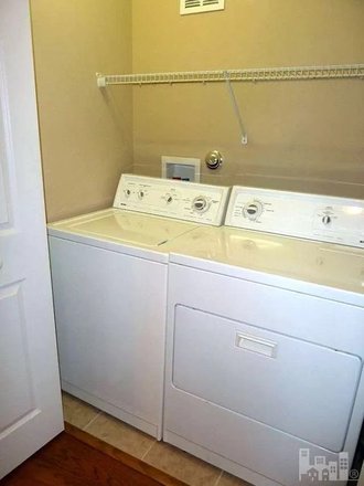 Laundry Room - Carleton Place Townhome.  Property connects to UNCW Campus!  Use of Pool Included!