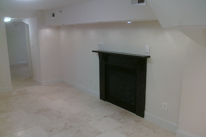 Fireplace with Mantle - Luxury 2 bedroom Condo Unit with fireplace