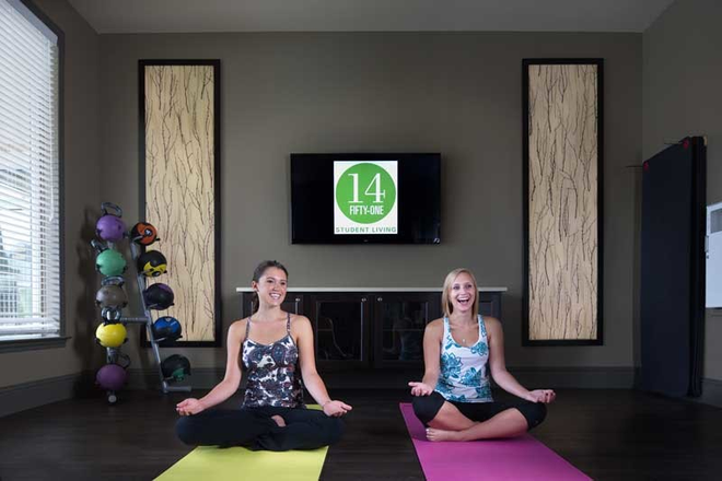 24-Hour Yoga and Dance Studio - 14 Fifty-One ALL INCLUSIVE Student Living - Voted BEST Community in Denton 4 Years In A Row! Apartments
