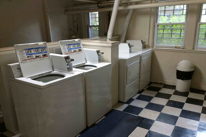 Laundry room - Guilford Hall, handsome 1920 Art Deco building in historic Okenshawe neighborhood. Apartments