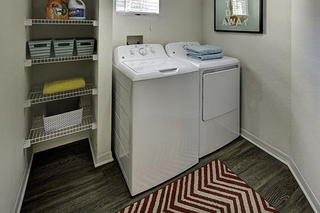 Laundry Room - Village at Science Drive Apartments