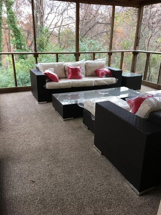 Screen porch with great seating.. so much more to this house