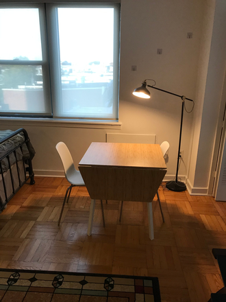 Main room dining table - Beautiful, Large, Furnished Studio, Art Museum Area, Free Gym and Shuttle, 2601 Parkway Condominiums