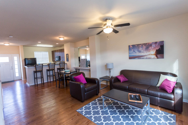 Large living area - The VUE at College Square Townhome