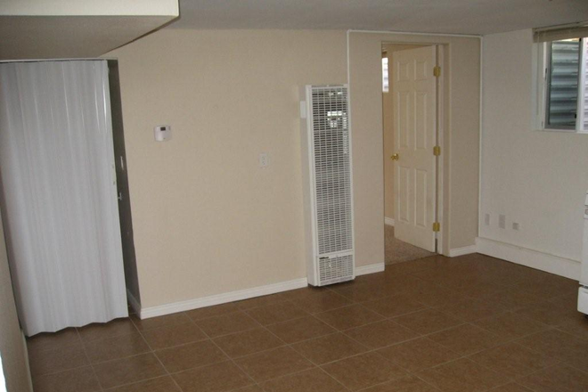 Living room1 - 1 Bedroom / 1 bath Apartment INCLUDES ALL UTILITES (BASEMENT UNIT)