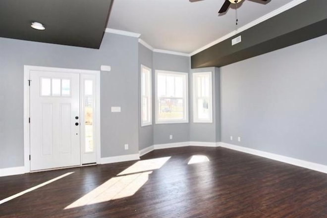 Open living space with bay windows - End-Unit Craftsman Style Townhouse in Cornerstone