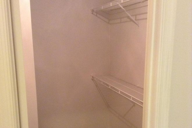 6. Walk-in master bedroom closet - Beautiful Bristol Commons Condo