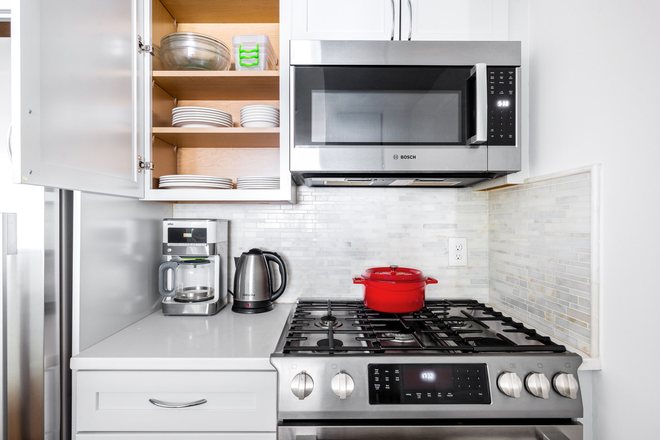 Kitchen - Furnished Mod Dupont Circle 2BR w/ W/D Apartments