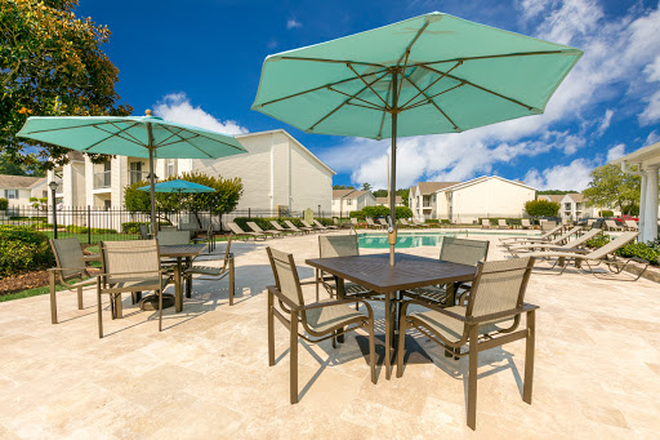 Covered seating at pool - Laurel Park - Conveniently located in Flowood with a $25 monthly discount! Apartments