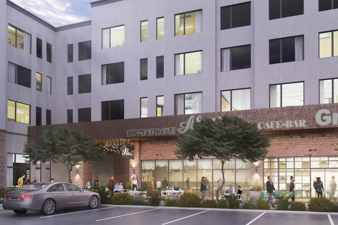 Exterior Building with Retail Space - Spur at Iliff Station Apartments
