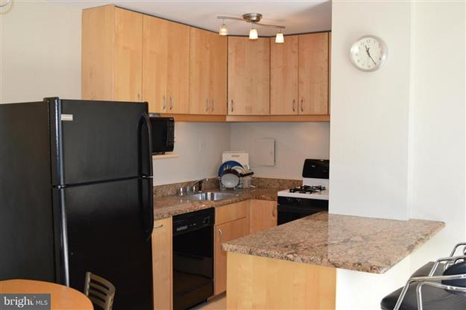 Kitchen - Furnished One Bedroom Condo