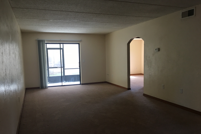 Looking In Extra Long Living Room - Marcell Garden Apartments with in minutes to your campus