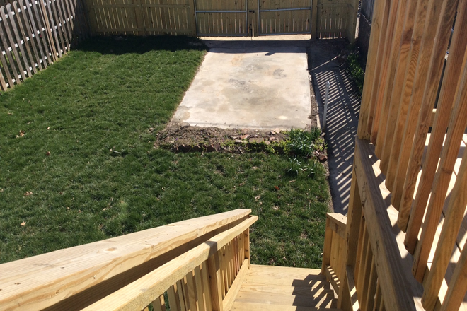 Fenced yard/Parking Pad