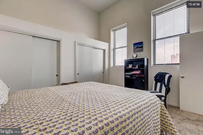 bedroom - 1211 light st #402 - Top floor 1 bedroom huge private deck VIEWS lots of storage & dedicated parking Apartments