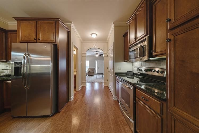 Kitchen to living room - Comfy-upscale townhome at the right price!