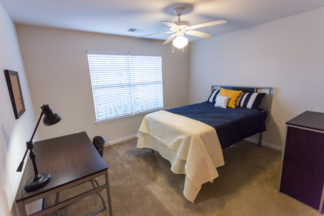 Large Bedroom w/ Full XL Bed - The VUE at Cornerstone Apartments