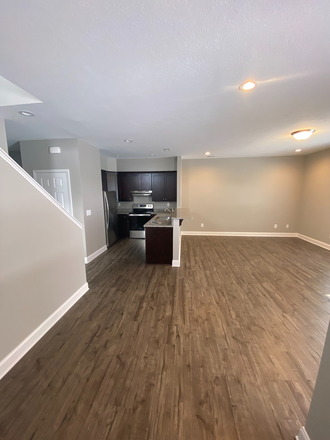 Dining room/living room/kitchen view - Villas at Riverside Townhome