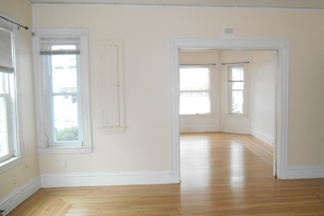 Living Area - Spacious and Charming Four Room Apartment with High Ceilings, Large Rooms + Off-Street Parking