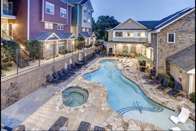 Pool Area - Premium Townhome Apartment Available! Move in as soon as you're available.