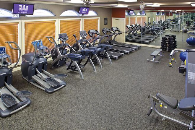 Fitness Center with Cardio Equipment, Strength Machines, and Free Weights