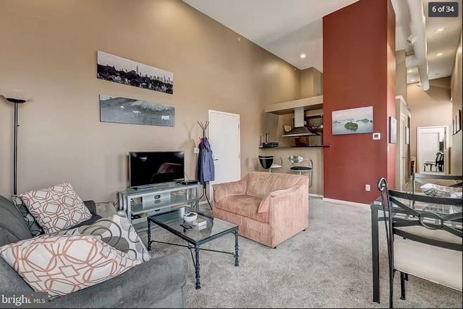 living area - 1211 light st #402 - Top floor 1 bedroom huge private deck VIEWS lots of storage & dedicated parking Apartments
