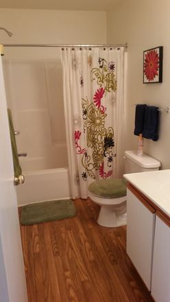 Full baths with modern floors, large vanity and medicine cabinet for extra storage