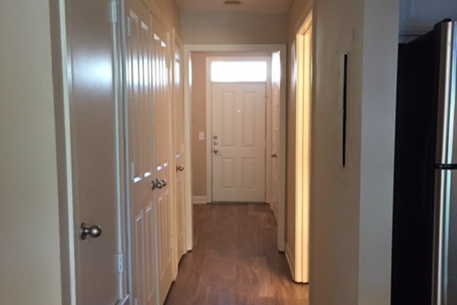 Plank wood flooring in upgraded units - Island Park & Harbor Town Square Apartments