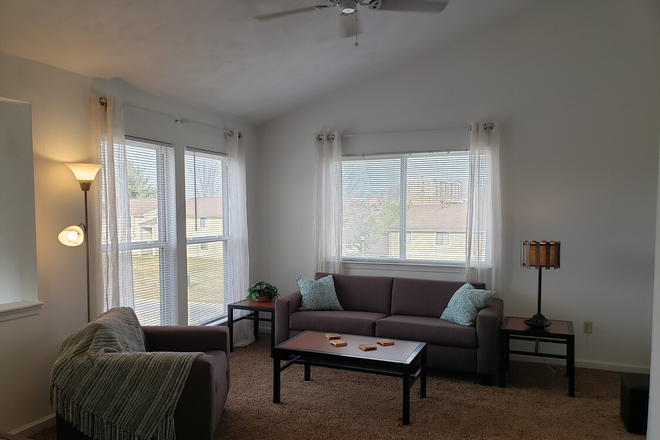 spacious second living room upstairs with vaulted ceilings and ceiling fans