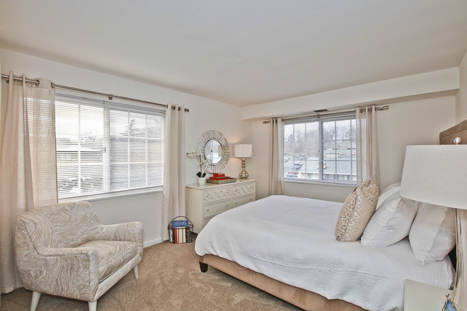 Luxurious Master Bedroom in Fairfax Apartment at Fairfax Square