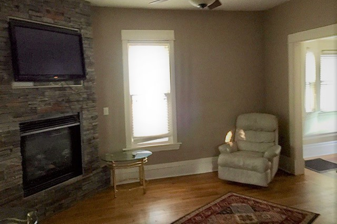 Front Living Room With Fireplace & TV - Excellent home in very good condition, main floor furnished; 4 Br + Den, 5-Star Landlord Rental