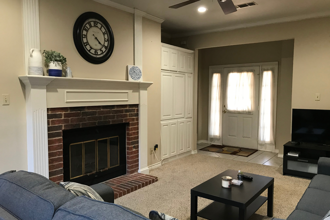 Living Room and Front Entry area - Furnished Women's Townhouse in Quiet Park Setting - 2 Bedrooms Available, near Discovery Park & TWU