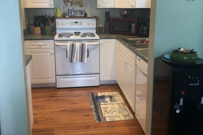 Full-functioning kitchen - Azalea Trace Condominiums