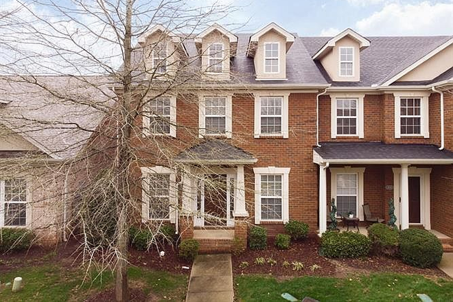 outside front of house - Comfy-upscale townhome at the right price!